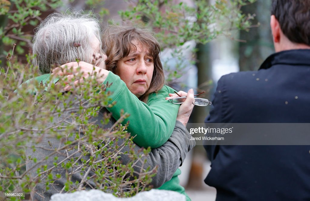 A woman reacts while being questioned by the Cambridge Police and other law enforcement agencies on April 19, 2013 near the home of suspect #2 on Norfolk Street in Cambridge, Massachusetts. Earlier, a Massachusetts Institute of Technology campus police officer was shot and killed late Thursday night at the school's campus in Cambridge. A short time later, police reported exchanging gunfire with alleged carjackers in Watertown, a city near Cambridge. According to reports, one suspect has been killed during a car chase and the police are seeking another - believed to be the same person (known as Suspect Two) wanted in connection with the deadly bombing at the Boston Marathon earlier this week. Police have confirmed that the dead assailant is Suspect One from the recently released marathon bombing photographs.