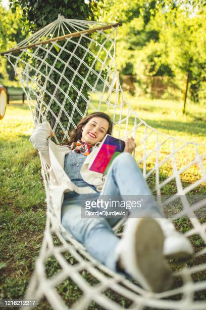 woman reading a book and swinging - week stock pictures, royalty-free photos & images