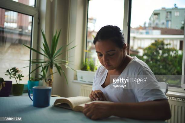 woman reading a book - spelling stock pictures, royalty-free photos & images