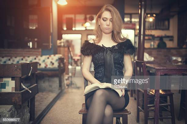 woman reading a book - women wearing short skirts stock pictures, royalty-free photos & images