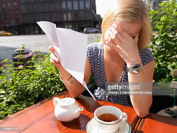 Woman reading a sad letter