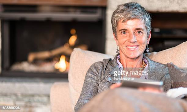 woman reading a tablet on the couch