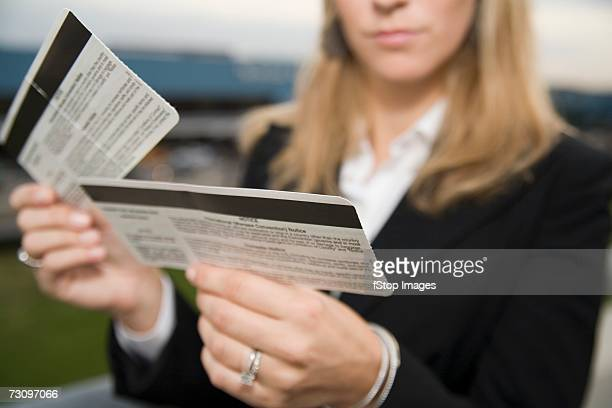 Woman reading airplane ticket