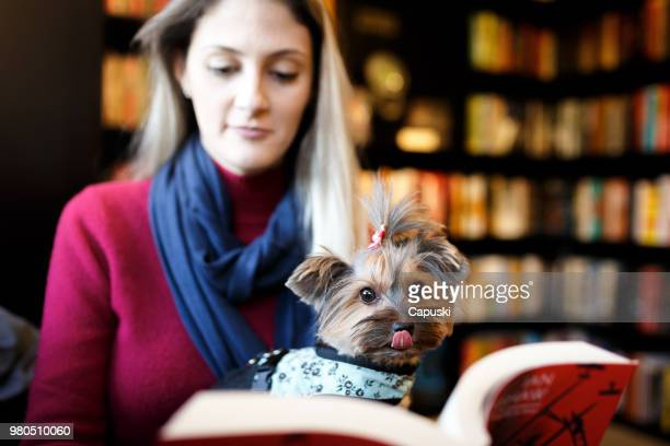 Woman reading at pet friendly book store