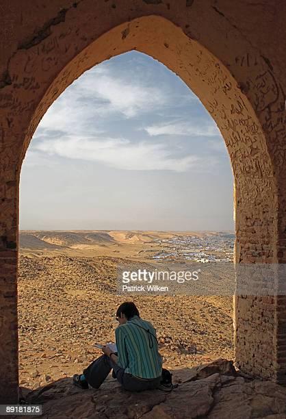 Woman reading at Qubbet el-Hawa near Aswan