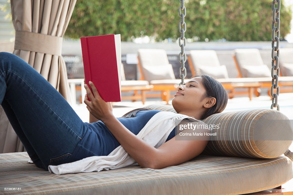 Woman reading book at home : Stock Photo