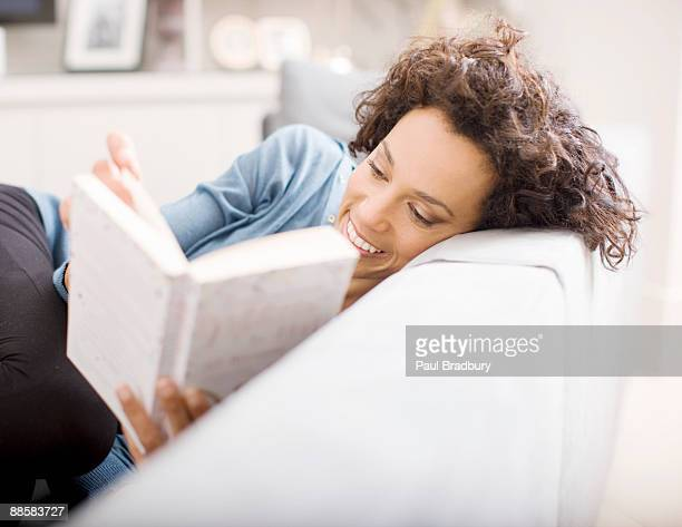woman reading book at home - reading stock pictures, royalty-free photos & images