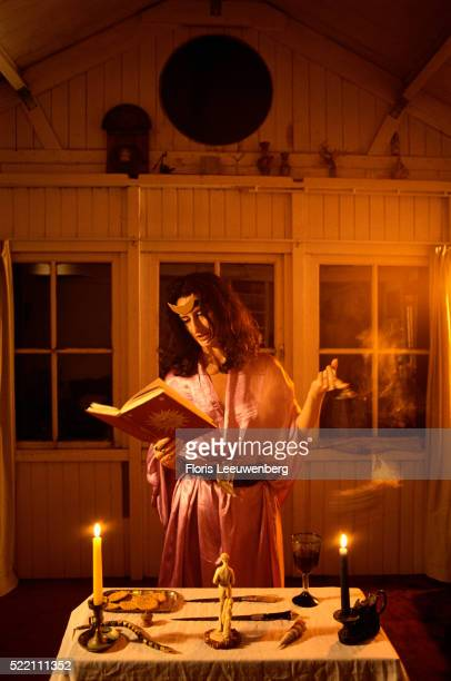 woman reading book of shadows - ceremony stock pictures, royalty-free photos & images