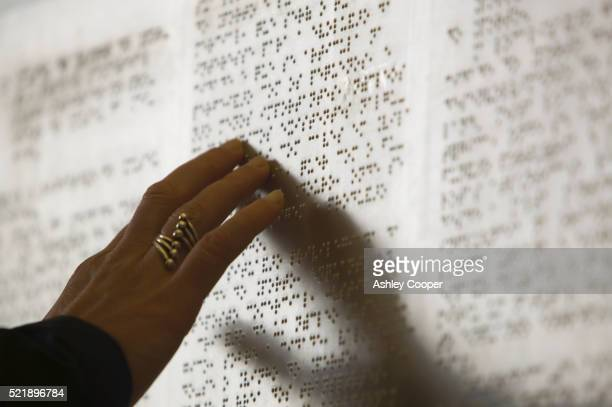 woman reading braille - braille stock pictures, royalty-free photos & images