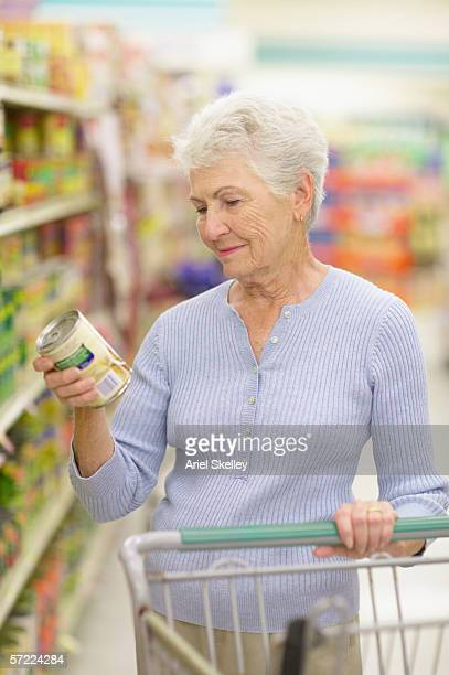 Woman reading can label in store