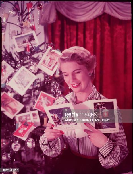 Woman reading Christmas cards c 1950 Photographic Advertising Limited founded in 1926 created multipurpose stock images with the potential for...