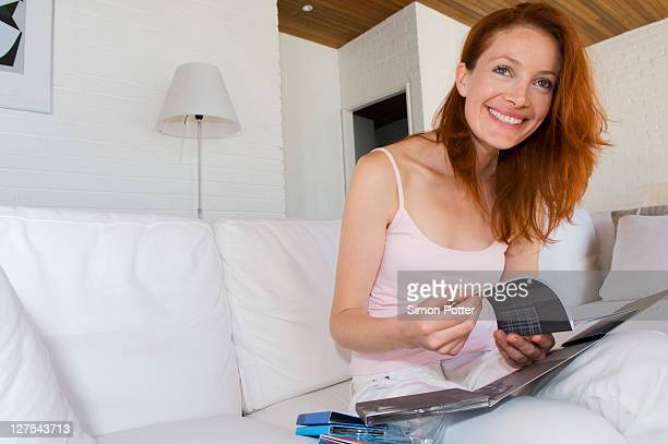 Woman reading compact disk booklet