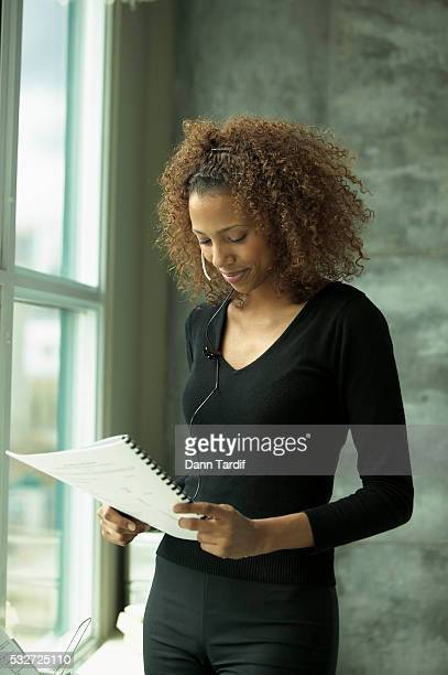 Woman Reading Document by Office Window