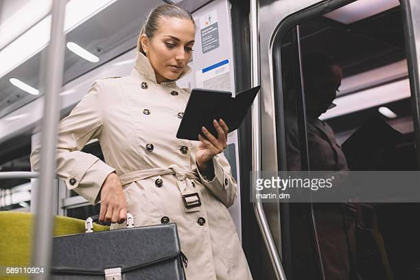 Woman reading e-book in the subway