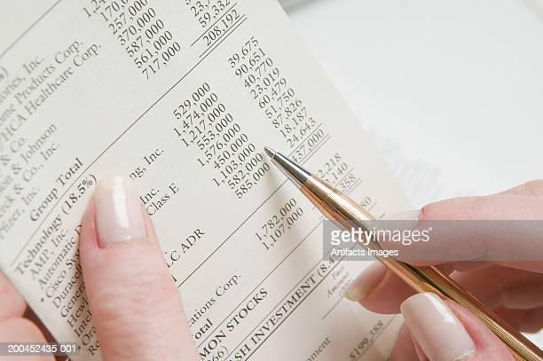 Woman reading financial planning report, close-up