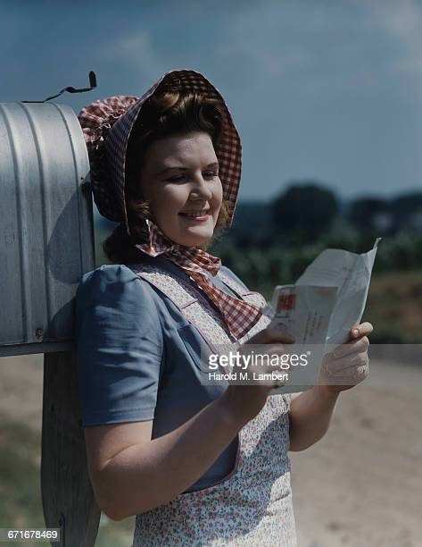 'Woman Reading Her Mail, Smiling '