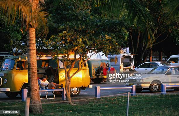 Woman reading in a combi van at Mindil Beach market.