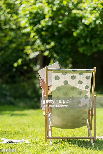 Woman reading in deck chair