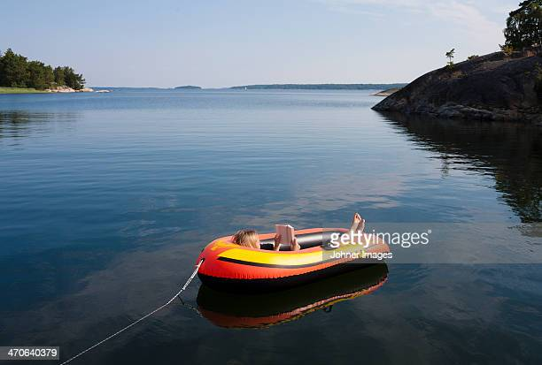 Woman reading in inflatable boat