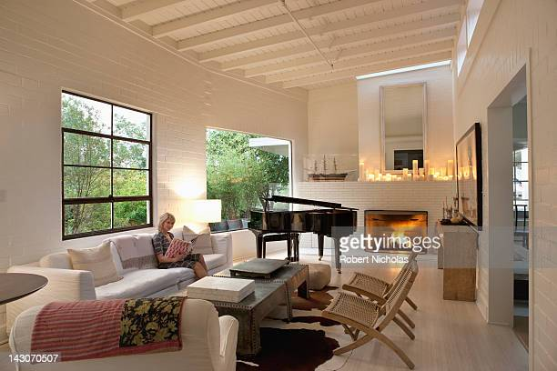 Woman reading in modern living room