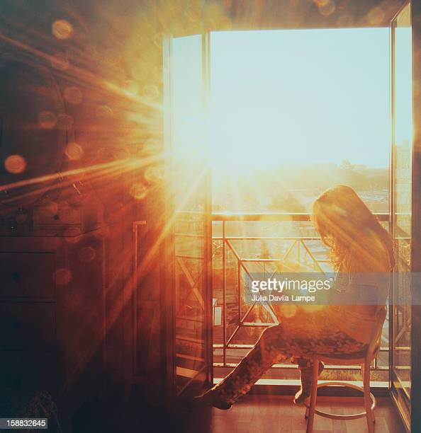 Woman reading in the morning sun
