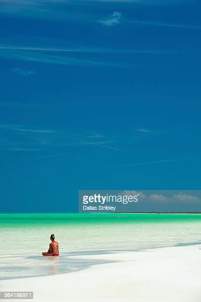 woman reading in the shallows, on holbox island - 2015 stock pictures, royalty-free photos & images