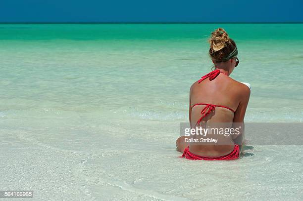 Woman reading in the shallows, on Holbox Island