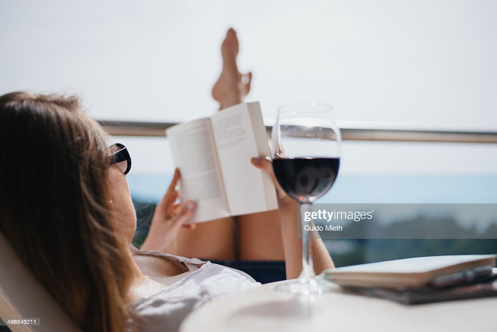 Woman reading in the sun : Stock Photo