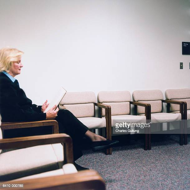 Woman Reading in Waiting Room
