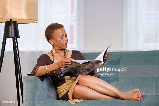 woman reading magazine - womans bare feet stock photos and pictures