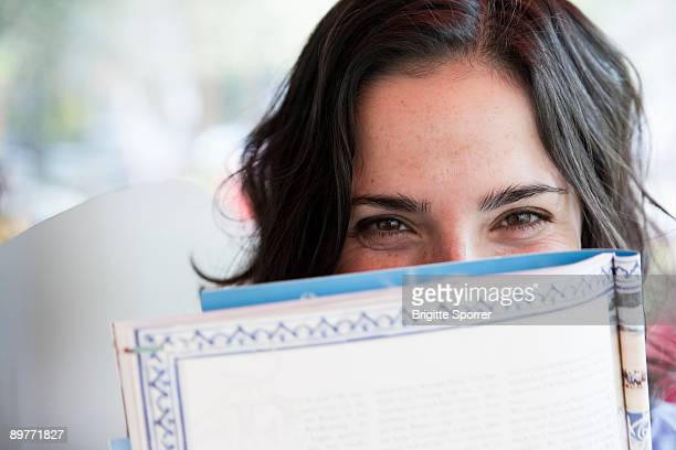 woman reading magazine - magazine stock pictures, royalty-free photos & images