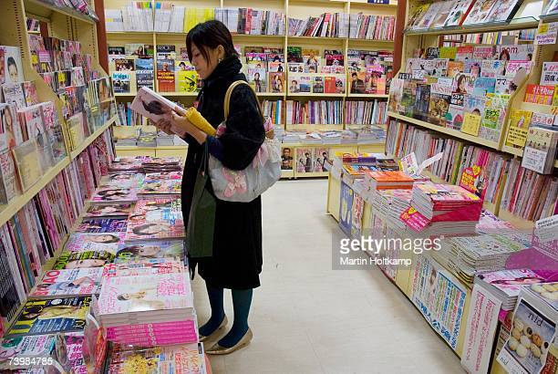 Woman reading magazines in a shop