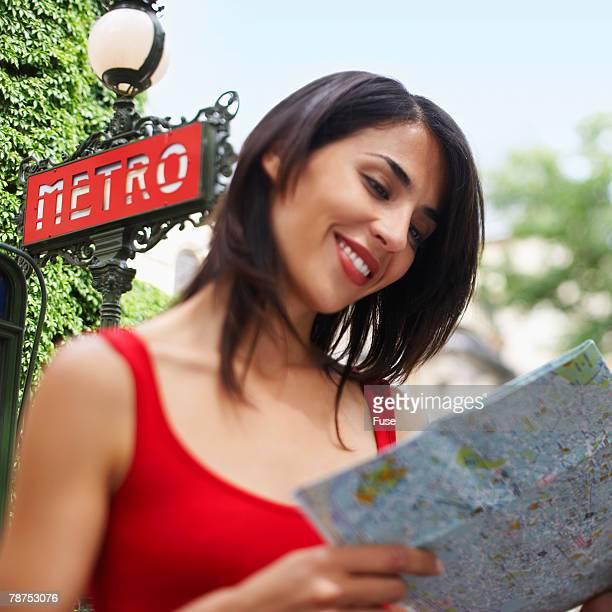 Woman Reading Map Outside Metro