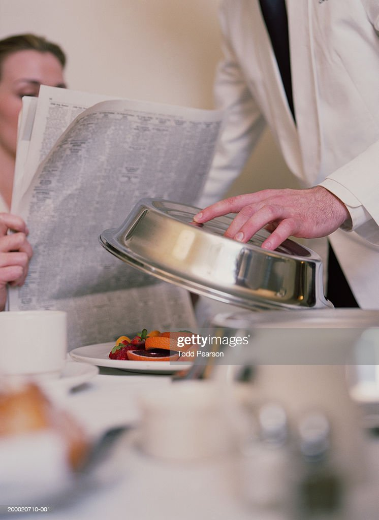 Woman Reading Newspaper While Being Served Room Service Stock ...
