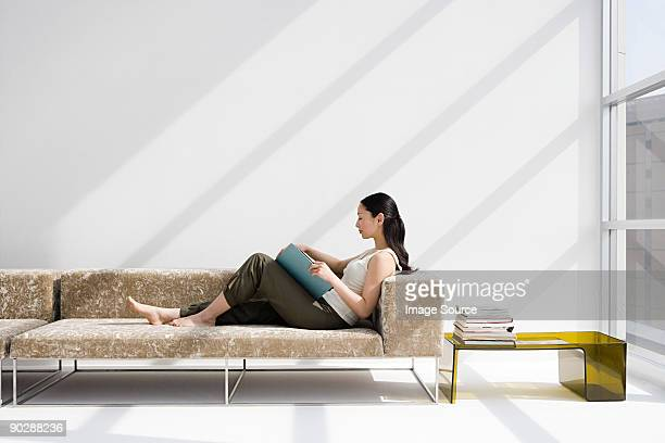 Woman reading on a sofa