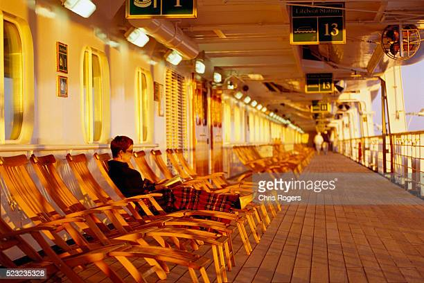 Woman Reading on Cruise Ship Deck