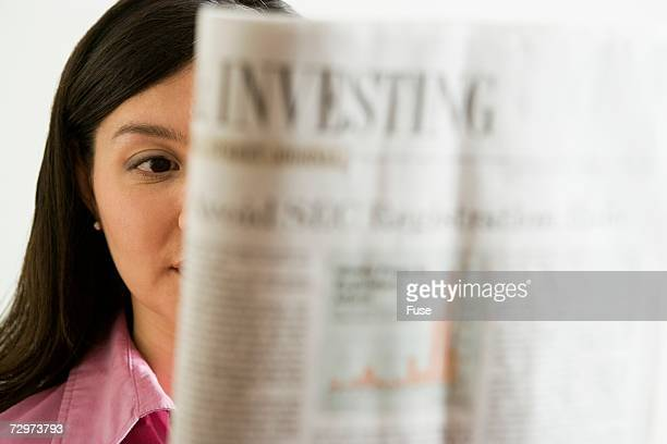 Woman reading the financial pages