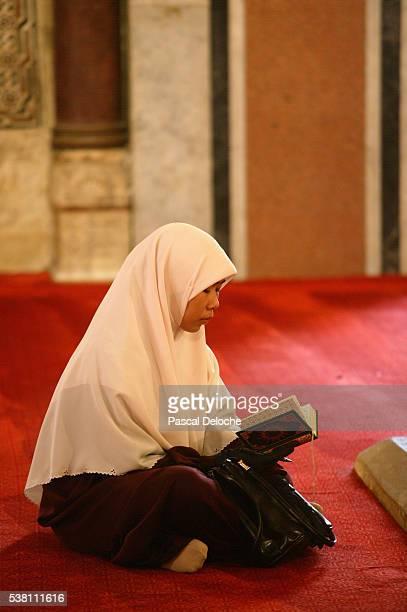 Woman Reading the Koran