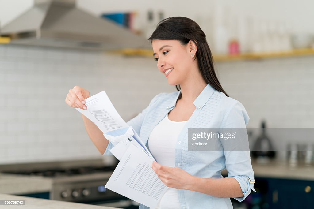 Woman reading the mail : Stock Photo