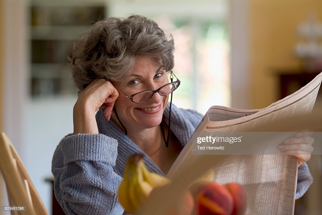 Woman Reading the Newspaper : Stock Photo