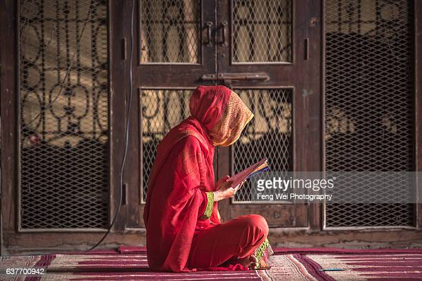 Woman Reading @ Wazir Khan Mosque, Lahore, Punjab, Pakistan