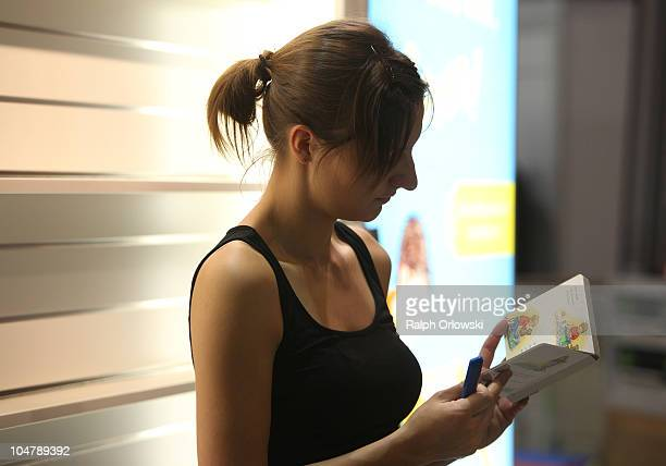 A woman reads a book during the preparations for the Frankfurt Book Fair 2010 on October 5 2010 in Frankfurt am Main Germany The Frankfurt book fair...