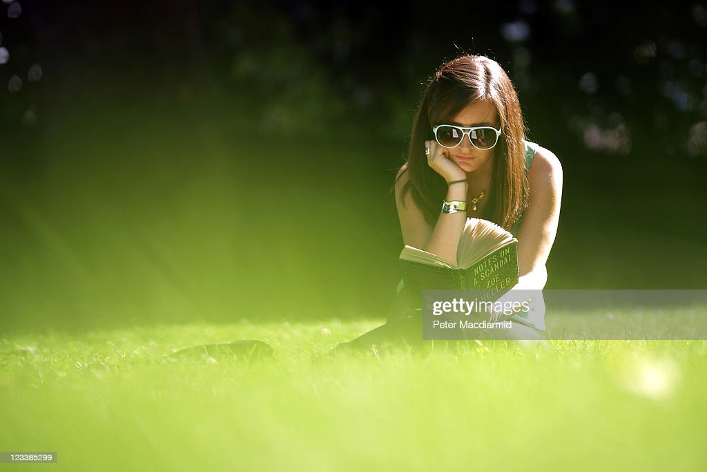 A woman reads a book in the sunshine in Victoria Tower Gardens on September 2, 2011 in London, England. After a lengthy wet spell London was bathed in sunshine for the second day with temperatures reaching 26 degrees centigrade.