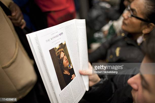 A woman reads a magazine on a subway car March 28 2011 in New York City In 2009 the New York City Subway delivered nearly 16 billion rides averaging...