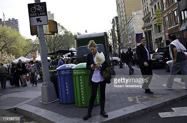 Woman reads a message on her hand held device April 20, 2011 in Union Square, New York.