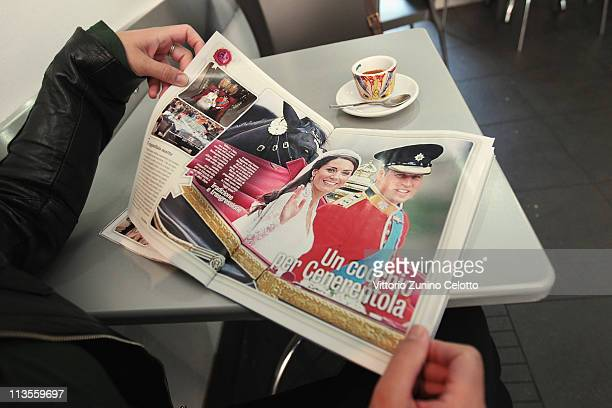 A woman reads an Italian magazine that shows pictures of the the Royal Highnesses Prince William Duke of Cambridge and Catherine Duchess of Cambridge...