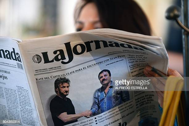 TOPSHOT A woman reads La Jornada newspaper in Mexico City on January 10 2016 which shows a picture of drug lord Joaquin Guzman aka El Chapo shaking...