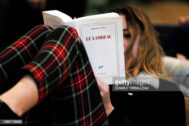 A woman reads the Femina prize 2018 'Le lambeau' by Philippe Lancon in the library 'Alexis de Tocqueville' in Caen northwestern France on December 5...