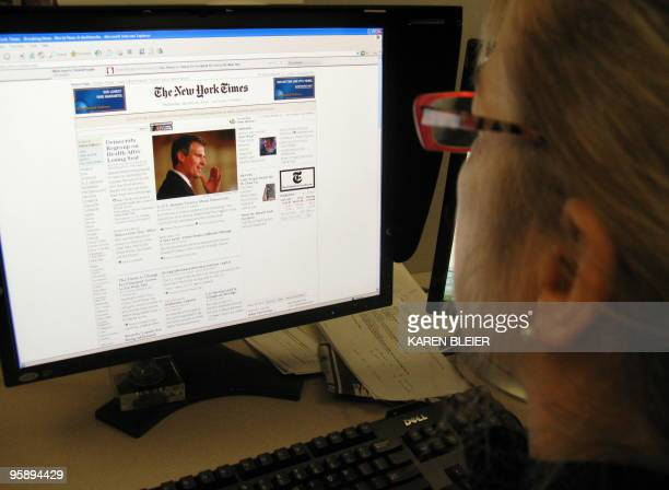 Woman reads the online version of the New York Times on January 20, 2010. The New York Times announced Wednesday that it will begin charging online...