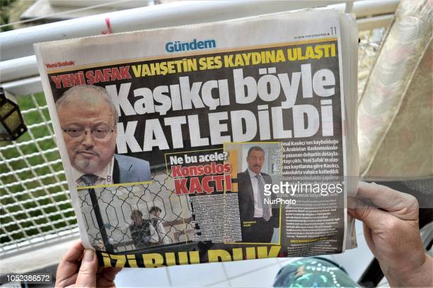A woman reads Yeni Safak a Turkish progovernment daily newspaper as the daily runs a headline that reads 'This is how Khashoggi was slaughtered' with...